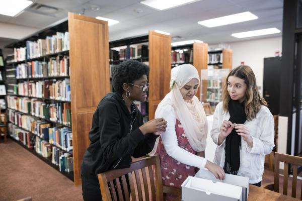 Alexis Bracey (left), Ayman Fatima (center) and Elizabeth Perez-Garcia (right) were three of the students who started with the project in summer 2017, bringing with them their backgrounds in criminology, public health, global affairs and other fields. Photo by Evan Cantwell.
