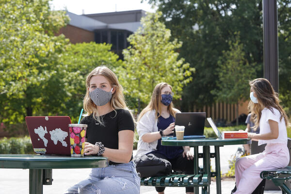 Students on campus wearing masks