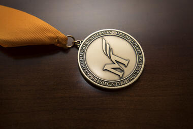 Faculty Excellence Award medal